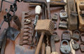 Hammer and rusty padlocks and planers in the workshop of flea ma Royalty Free Stock Photo