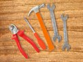 Hammer screwdriver and wrenches over wooden background Royalty Free Stock Images