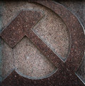 Hammer and sickle made of granite soviet symbol Stock Photos