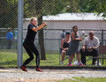 Hammer throw a female athlete swings and makes her first attempt during a track meet in redding california on may Stock Images