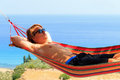Hammock boy young man relaxing in a on the island of zakynthos greece Stock Images