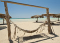 Hammock on a desert island beach tropical with view out to sea Royalty Free Stock Images