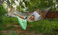 Hammock in the garden girl a Stock Photography