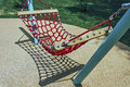 Hammock for kids toy located in an amusement park children Stock Photos