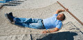 Hammock man middle age enjoying a on the beach Stock Images