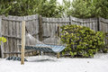 Hammock in the shadow by the wooden fence Royalty Free Stock Image