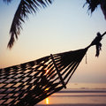 Hammock sunset abstract vacations tropics Royalty Free Stock Images