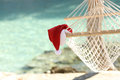 Hammock on a tropical beach resort in christmas holidays with the sea water the background Stock Photography