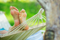Hammock and woman feet Royalty Free Stock Photography
