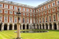 Hampton court palace courtyard london is a royal in the borough of richmond upon thames greater uk Royalty Free Stock Photos