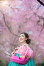 Hanbok the traditional korean dress and beautiful asian girl wi with sakura Stock Photos