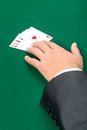 Hand with aces on the green table Stock Photos