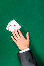 Hand with aces on the poker table Stock Image