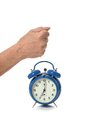 Hand and alarm clock human closeup on white background Stock Photo