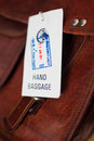 Hand baggage and label at the airport closeup Royalty Free Stock Image