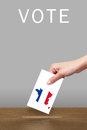 Hand with ballot and wooden box Royalty Free Stock Photography