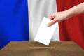 Hand with ballot and wooden box on Flag of France Stock Images