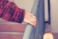 Hand on banister Stock Photo