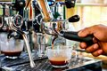 Hand of Barista making espresso coffee with the coffee machine in the coffee shop or cafe, Foods and drink concept Royalty Free Stock Photo