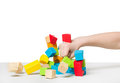 Hand beating house made of color wooden blocks human Royalty Free Stock Photos