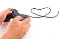 Hand on black game controller Stock Images