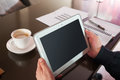 Hand and blank screen digital tablet with in coffee shop Royalty Free Stock Photography