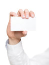 Hand with blank visiting card isolated on white Royalty Free Stock Image