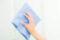 Hand with blue sponge cleaning the bathroom glass Royalty Free Stock Photo
