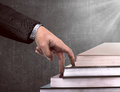 Hand and book stairs Royalty Free Stock Photo