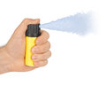 Hand with bottle of pepper spray isolated on white background Royalty Free Stock Photography