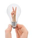 Hand with bulb and victory sign Royalty Free Stock Photo