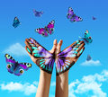 Hand and butterflys butterfly painting tattoo over a blue sky concept for spiritual symbol of soul Royalty Free Stock Photography