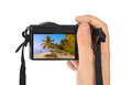 Hand with camera and maldives beach photo my photo isolated on white background Royalty Free Stock Photography