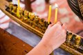Hand candle in thai temple Stock Photo