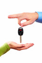 Hand with a car key isolated on white background Stock Photo