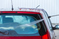 Hand car wash rear window by with water jet pressure Stock Image