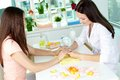 Hand care consultancy dermatologist consulting her client on Royalty Free Stock Images