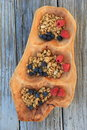 Hand carved wood platter with fresh seasonal fruit and granola beautiful filled the wholesomeness of fruits crunchy Stock Images