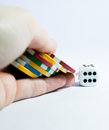 Hand with casino chips and dice seven a white Stock Images