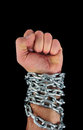 Hand with chains a as punch Royalty Free Stock Photo