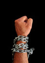 Hand with chains a as punch in black background Royalty Free Stock Images