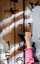 Hand of child and door of the street Stock Image