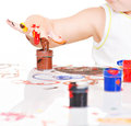 Hand of a child with paints closeup isolated on white Stock Photo