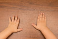 Hand of a child the s on wooden tablehand Royalty Free Stock Photo