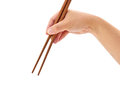 Hand with chopsticks Stock Images