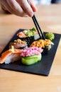 Hand chopsticks grabbing nigiri sushi Royalty Free Stock Images