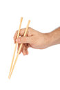 Hand with chopsticks isolated on white background Stock Image