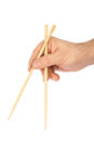 Hand with chopsticks Royalty Free Stock Photo
