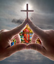 Hand church with cross stained glass against sky Royalty Free Stock Photos