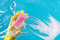 Hand cleaning glass window pane with detergent Royalty Free Stock Photo